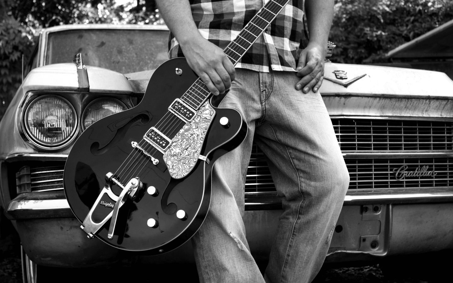 37 records and management image guy holding guitar leaning on caar